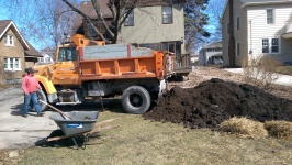 First, Dennis unloads the compost. It smells wonderful!