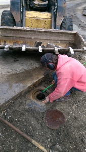 Dennis runs water into the pipe and confirms that indeed it drains. But to where? Storm sewer?